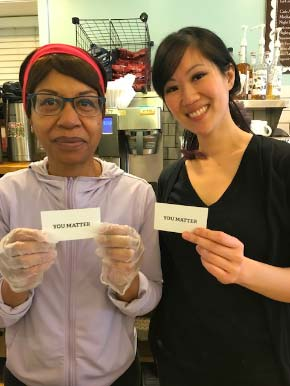 Photo: 2 women with You Matter cards